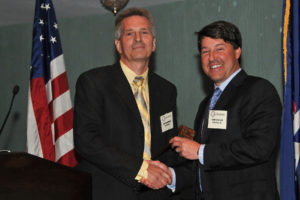 Outgoing President Rick MacDonald passing the gavel to Chris Traylor. Pic credit: Robert Radske